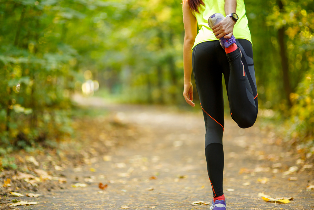 woman exercising and stretching muscles
